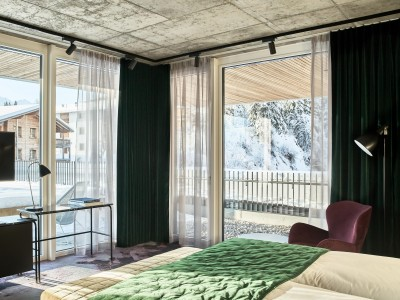 The Hide Hotel Flims Junior Suite Bedroom view in Flims