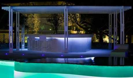 Ekies All Senses Resort Swimming Pool by Night in Halkidiki