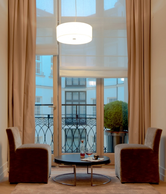 High Window Comfortable Chairs And Small Table With Drinks Design Hotels Member